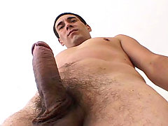 Handsome man with really hot body jerking off his hard dick